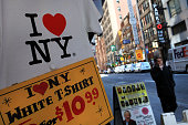 A shirt bearing the 'I Love New York' logo are displayed at a store in Times Square on May 10 2010 in New York City As a result of a $92 billion...