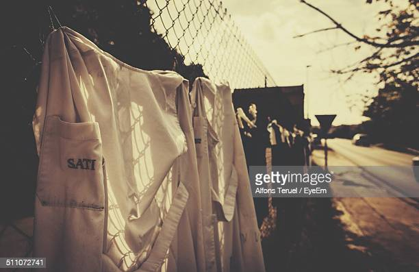 Shirt drying against fence