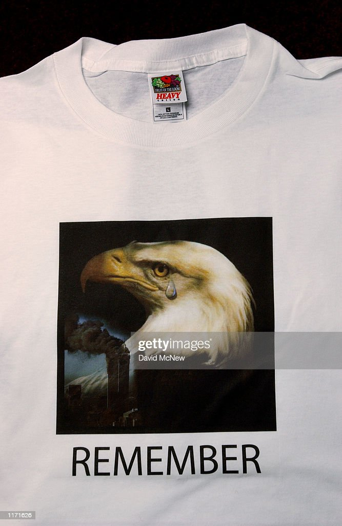 A shirt memorializing the attack on the World Trade Center is one of about a dozen warrelated designs produced by Impact Products LLC October 17 2001...