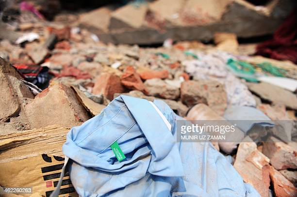A shirt with a Benetton label lies in the rubble three days after a Bangladeshi garment eightstorey building collapsed in Savar on the outskirts of...