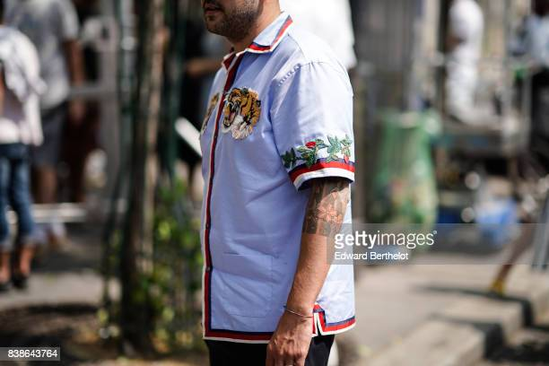 A shirt with embroidered flowers red lining and an embroidered tiger outside the Y/Project show during Paris Fashion Week Menswear Spring/Summer 2018...