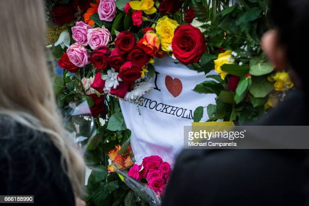 A shirt with 'I Love Stockholm' is left at the scene at the site of the terrorist truck attack in downtown of the city where sympathy flowers are...