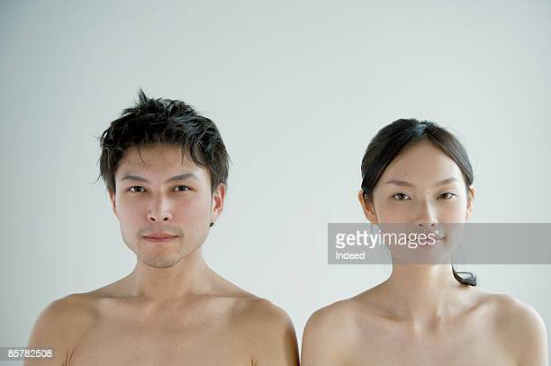 Shirtless man and woman in side by side