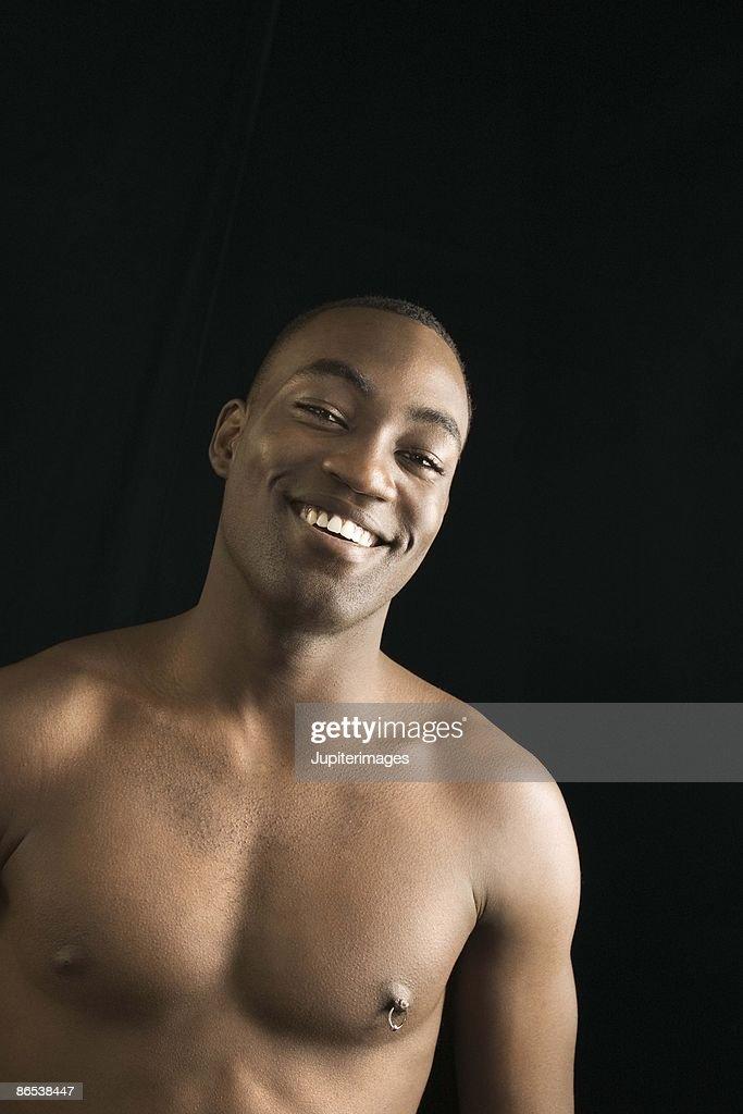 Shirtless man smiling : Stock Photo