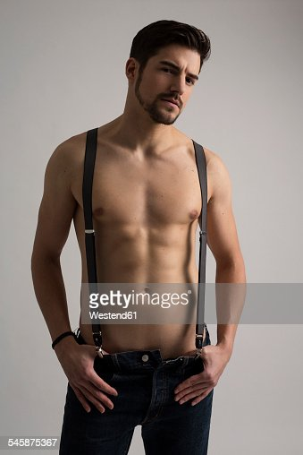 Shirtless Man Wearing Jeans And Suspenders Stock Photo ...