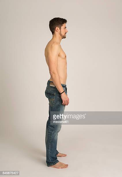 Shirtless man wearing jeans
