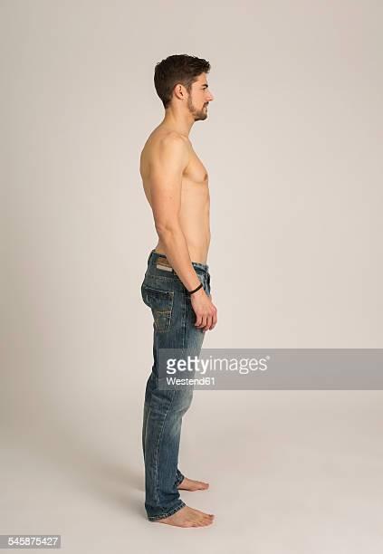 Shirtless man wearing jeans