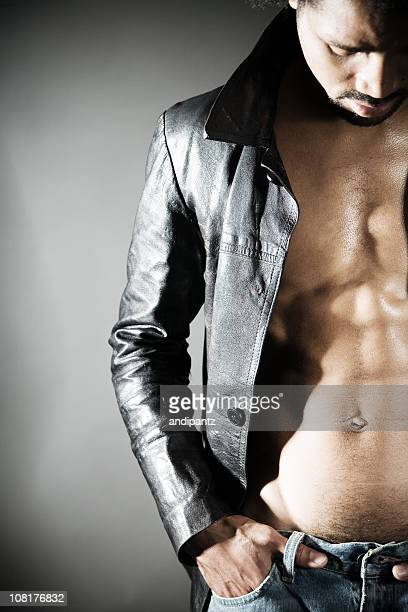 Shirtless Man Wearing Leather Jacket Showing Chest