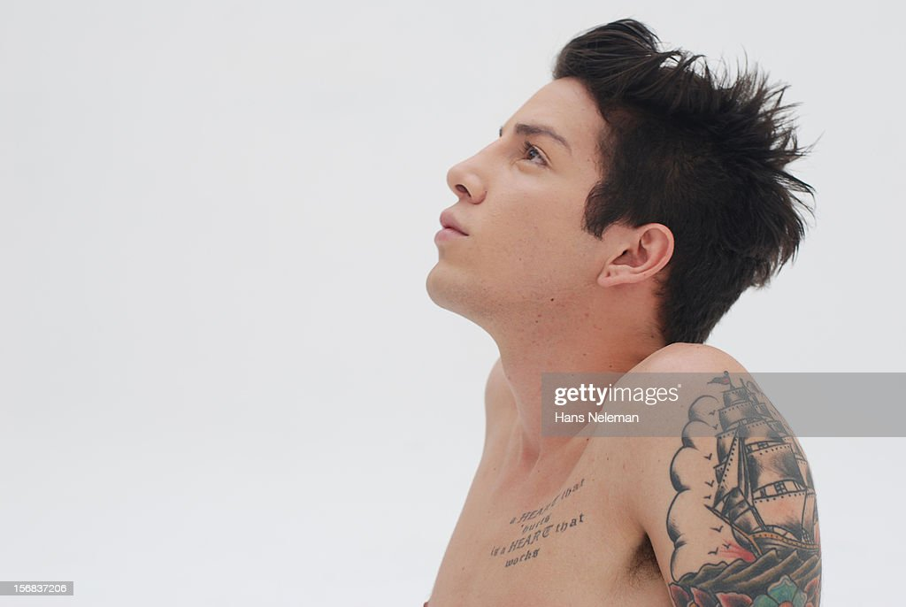 Shirtless man with tattoos : Stock Photo