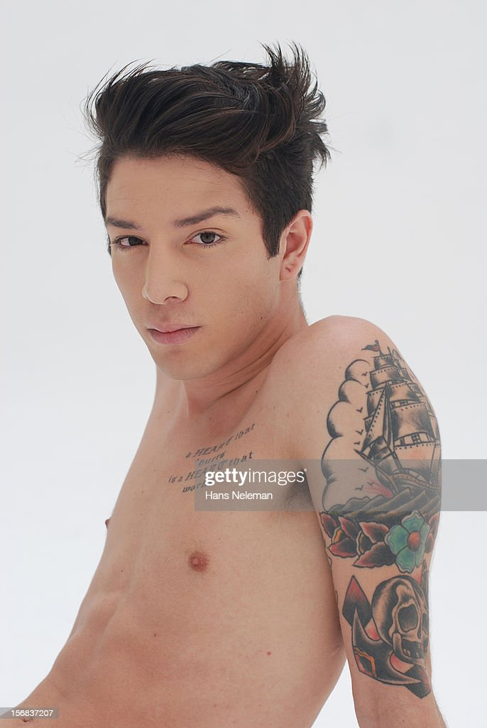 Shirtless man with tattoos : Stock Photo