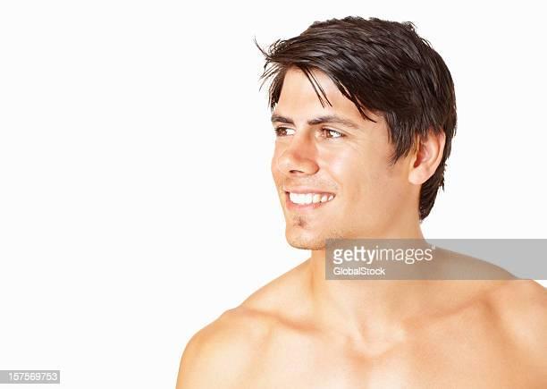 Shirtless smiling man looking at copyspace