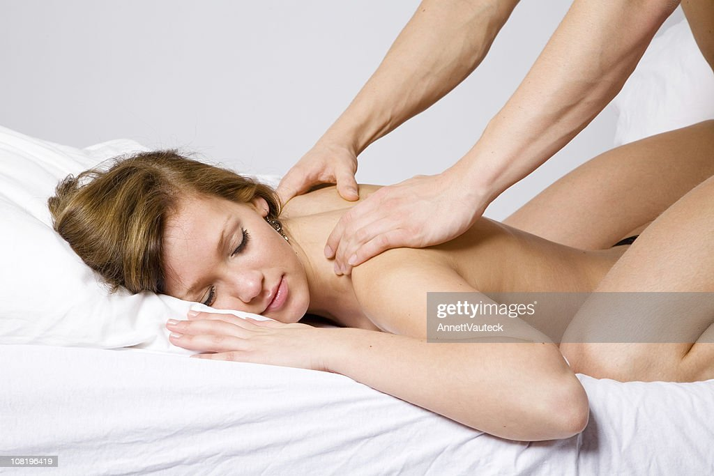 Shirtless Woman Receiving Back Massage from Man : Stock Photo