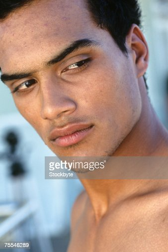 Shirtless young man looking over shoulder,close-up : Stock Photo
