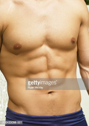 Shirtless young man, mid section : Stock Photo