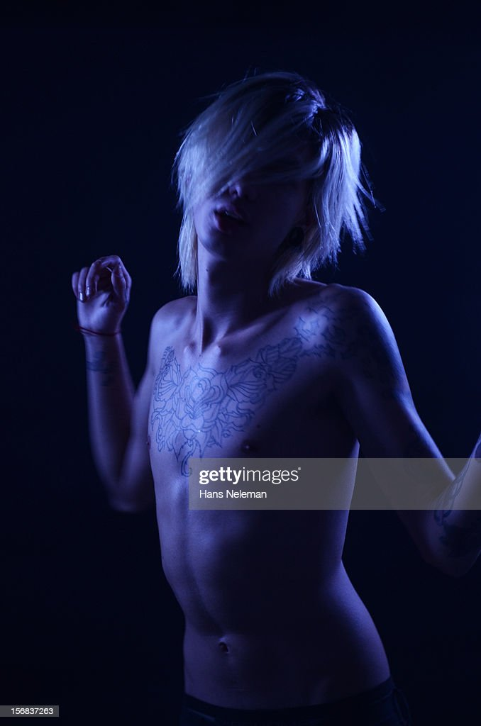 Shirtless Young Man with tattoos : Stock Photo