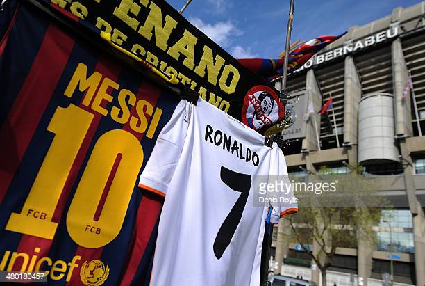 Shirts bearing the names of Lionel Messi of FC Barcelona and Cristiano Ronaldo of Real Madrid CF are see at a merchandise stall prior to the La Liga...