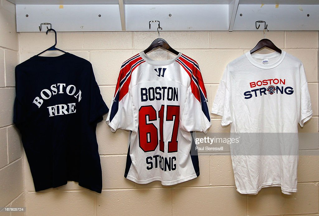 shirts hang in the dressing room of the Boston Cannons during a Major League Lacrosse game against the New York Lizards at James M. Shuart Stadium on April 28, 2013 in Hempstead, New York. The jersey in center is going to be signed by the Cannons players and auctioned off to benefit the victims of the Boston terrorist attacks.