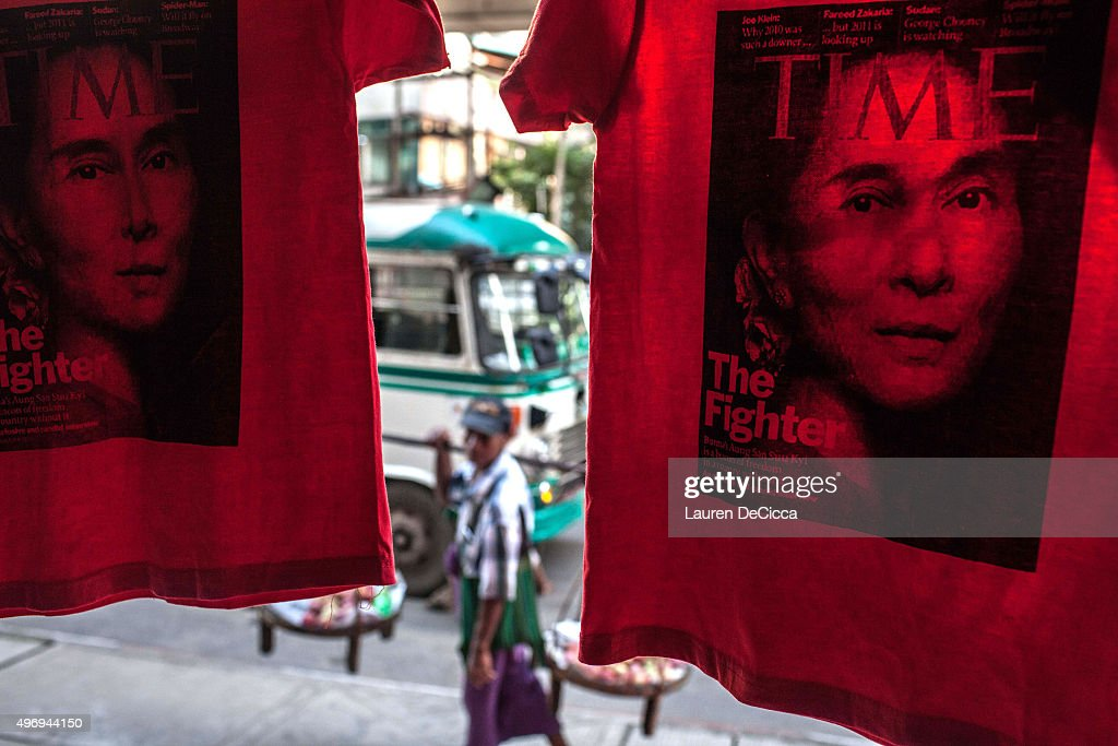 Shirts with Aung Sun Suu Kyi's TIME magazine cover printed on them hang near the National League for Democracy headquarters in Yangon on November 13...