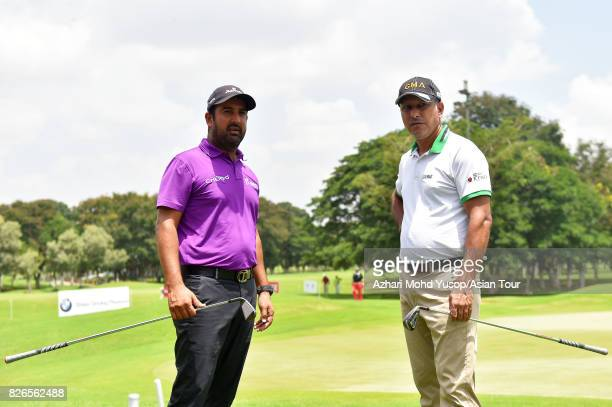 Shiv Kapur of IND and Jeev Milkha Singh of IND pose for picture ahead of the TAKE Solutions Masters at Karnataka Golf Association Golf Course on...