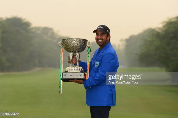 Shiv Kapur of India pose with the trophy after winning the Panasonic Open India at Delhi Golf Club on November 5 2017 in New Delhi India