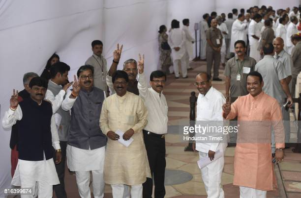 Shiv Sean Indian lawmakers line up to cast their votes during the presidential election at the Parliament House on July 17 2017 in New Delhi India...