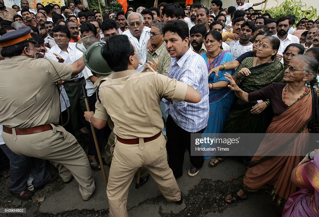 Shiv sena activist argues with police just before Narayan Rane's first public meeting at Prabhaev. Expelled shiv sena leader Rane addressed his first public meeting after resigning from the Maharashtra assembly in Sena's stronghold in Prabhadevi
