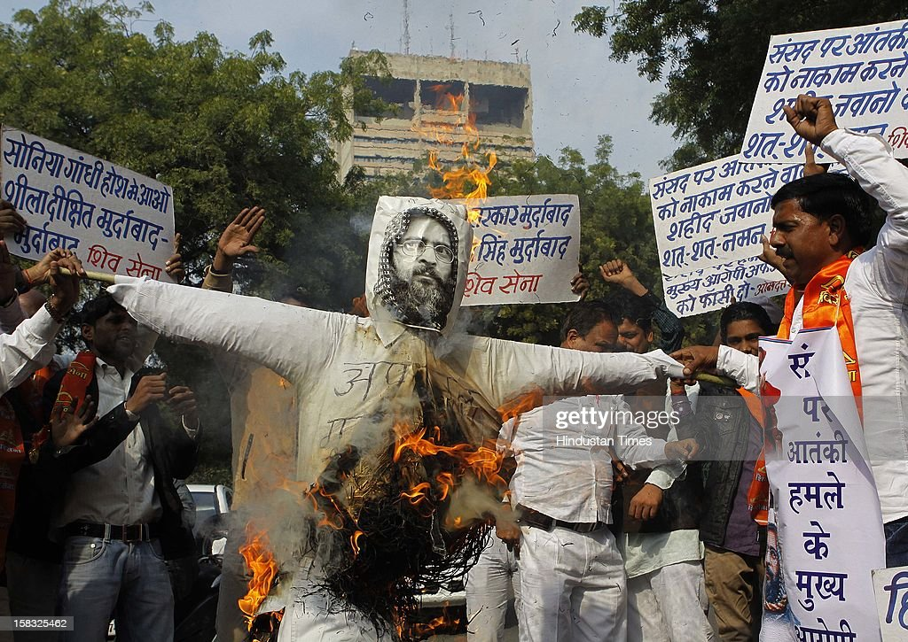 Shiv Sena Activist burn the effigy of Afzal Guru, a Jaish-e-Mohammad terrorist convicted of the December 2001 attack on the Parliament, demanding to be hanged during a protest at Jantar Mantar on December 13, 2012 in New Delhi, India. 14 persons were killed in terrorist attack on Indian Parliament on December 13, 2001.