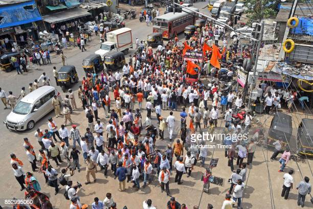 Shiv Sena activists protest against BJP government for the rising prices of petrol and diesel at Kurla on September 23 2017 in Mumbai India The...