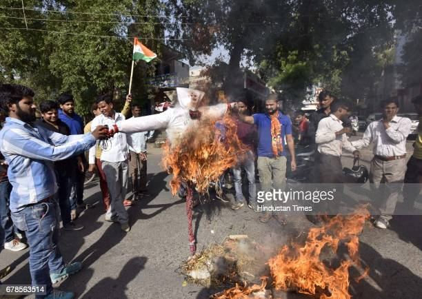 Shiv Sena activists protest against the Centre Government putting bangles lipstick and bindis on the effigy of the PM before burning it and demand...