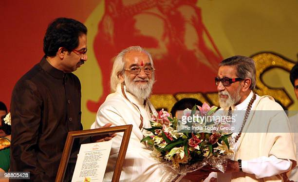 Shiv Sena chief Bal Thackeray and executive president Uddhav Thackeray honour historian Babasheb Purandare during Maharashtra Day celebration at...