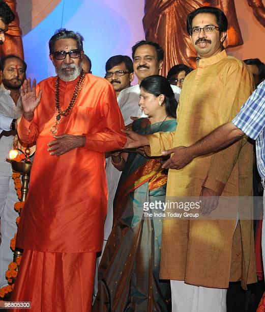 Shiv Sena chief Bal Thackeray with his son and Sena's executive president Uddhav Thackeray interact with media during the inauguration of the...