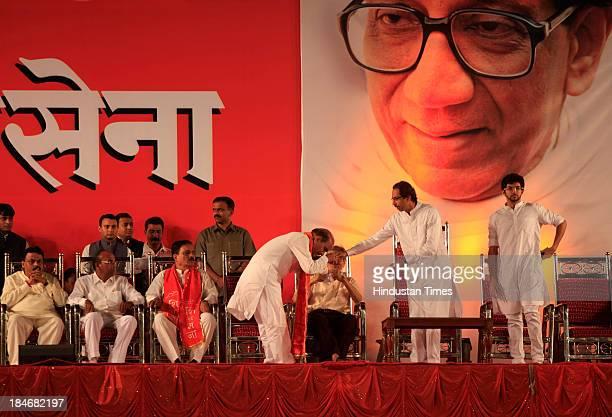 Shiv Sena Chief Uddhav Thackeray being given a token of respect by party senior leader Manohar Joshi at Shiv Sena Dussehra Rally at Shivaji Park...