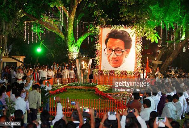 Shiv Sena Chief Uddhav Thackeray with his wife Rashmi Thackeray and son Aditya Thackeray inaugurate firelight at Shivaji Park on the occasion of Late...