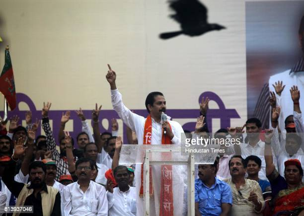 Shiv Sena Executive President Uddhav Thackeray with RPI President Ramdas Athawale and Shiv Sena MP Sanjay Raut during a joint rally called by the...