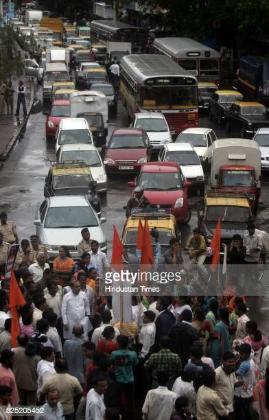 Shiv Sena leader Manohar Joshi leading a rastaa roko opposite Sena Bhawan at Dadar to protest against the fule hike and inflation
