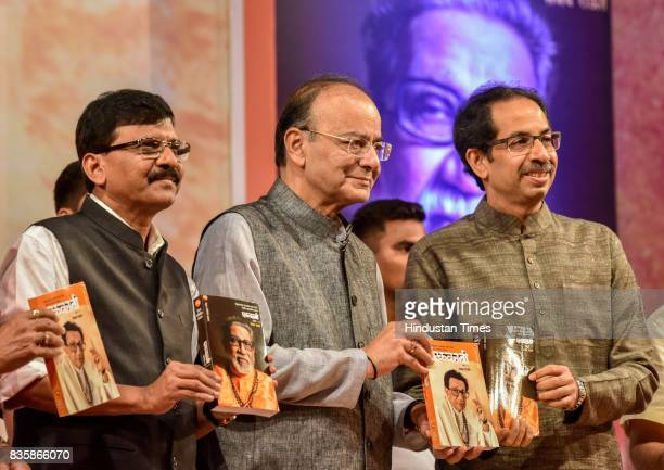 Shiv Sena MP Sanjay Raut Union Minister Arun Jaitley and Shiv Sena Chief Uddhav Thackeray during the release of a compilation of a hundred interviews...