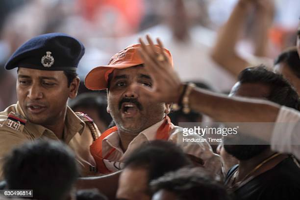 Shiv Sena party workers and BJP party workers shout slogans against each other during the Prime Minister Narendra Modi's foundation stone laying...