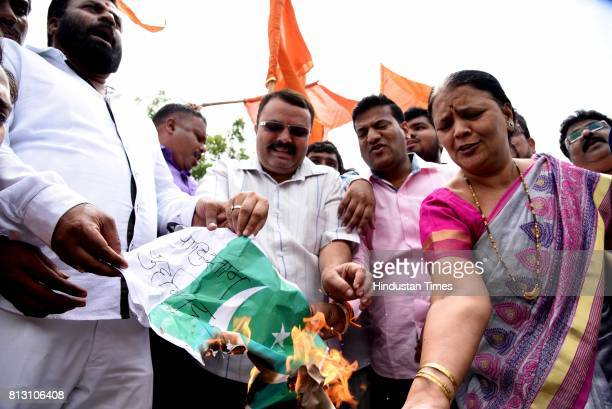 Shiv Sena party workers protest against the terror attack on Amarnath Yatra in Jammu and Kashmir at Shivaji Chowk Vashi on July 11 2017 in Mumbai...