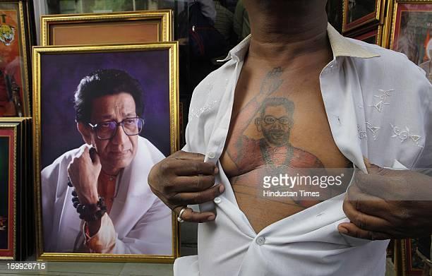 Shiv Sena supporter flaunts a tattoo of Shiv Sena Supremo Late Bal Thackeray done on his chest at Shiv Sena Bhavan Shivaji Park on the later's 87th...