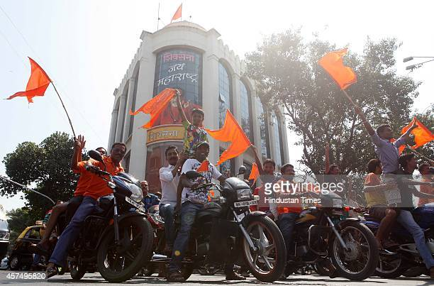Shiv Sena supporters celebrate the win of their candidate Sada Sarvankar from Mahim Assembly constituency outside Shiv Sena Bhavan Dadar on October...