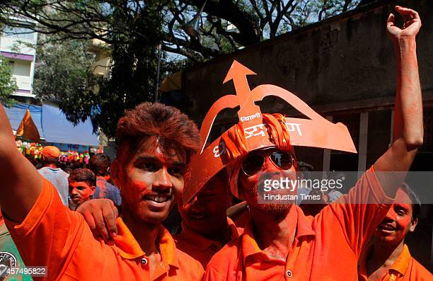 Shiv Sena supporters celebrate the win of their candidate Sada Sarvankar from Mahim Assembly constituency at Dadar on October 19 2014 in Mumbai India...