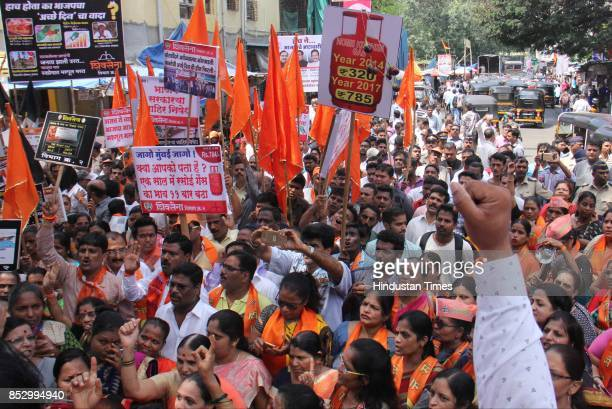 Shiv Sena supporters protest against BJP government for the rising prices of fuel vegetables and food grains at Kandivali on September 23 2017 in...