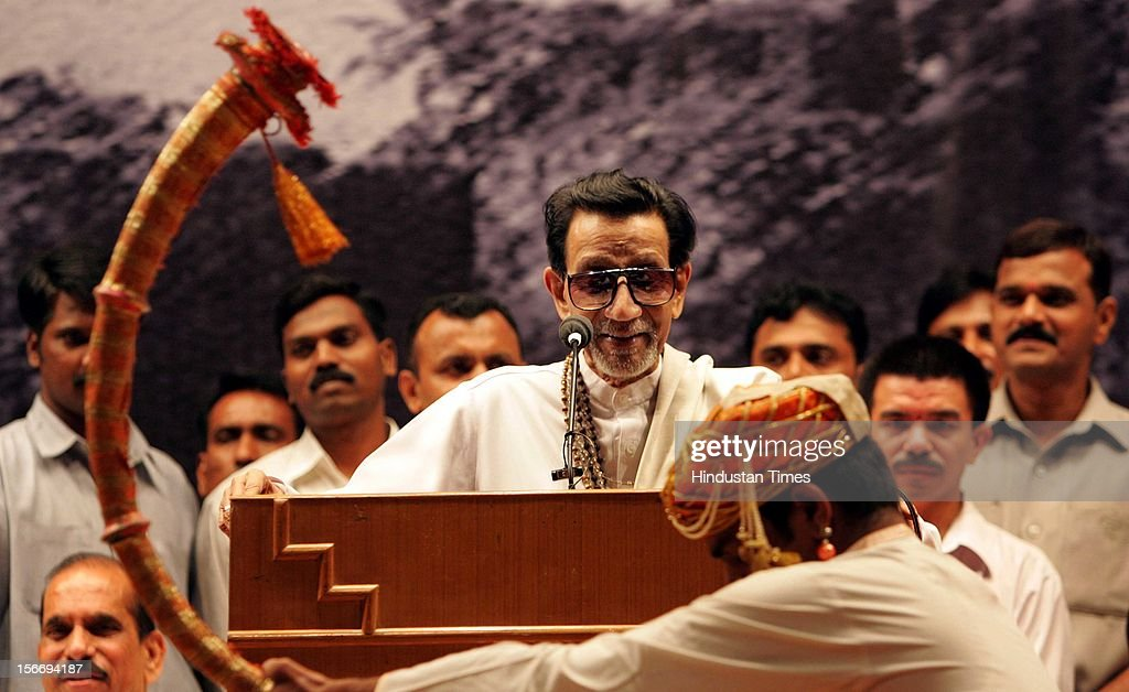 Shiv Sena Supremo Balasaheb Thackeray smiles at the traditional 'Tutari' player welcome him on stage at Shanmukhanand Hall on September 2, 2005 in Mumbai, India. This was his first public appearance since Narayan Rane left the party.