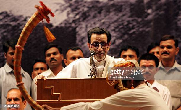 Shiv Sena Supremo Balasaheb Thackeray smiles at the traditional 'Tutari' player welcome him on stage at Shanmukhanand Hall on September 2 2005 in...