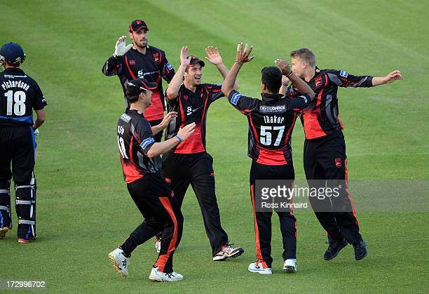 Shiv Thakor of the Leicestershire Foxes celebrates after he kicks the ball onto the stumps to run out Michael Richardson of Durham Dynamos during the...