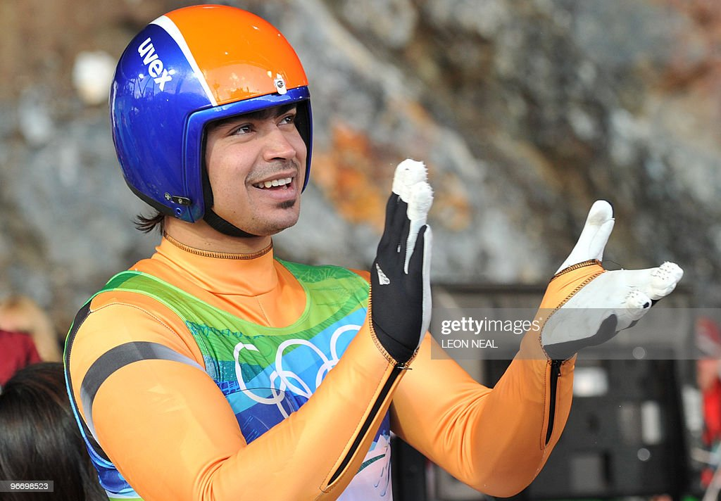 Shiva K.P. Keshavan of India cheers after finishing the men's luge singles run 4 at the Whistler sliding centre on February 14, 2010 during the Vancouver Winter Olympics. AFP PHOTO / LEON NEAL