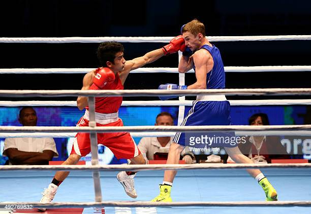 Shiva Thapa of India fights Dzmitry Asanau of Belarus in the final of the Men's Bantam Weight during the AIBA World Boxing Championships Doha 2015 at...
