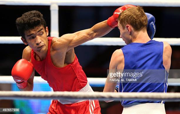 Shiva Thapa of India fights with Dzmitry Asanau of Belarus during the final of Men's Bantam weight of the AIBA World Boxing Championships in Doha on...