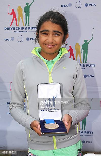 Shivani Dora in a tie for first place winner in the Girls 1011 Driving Competition poses with her medal during the 2015 Drive Chip and Putt...