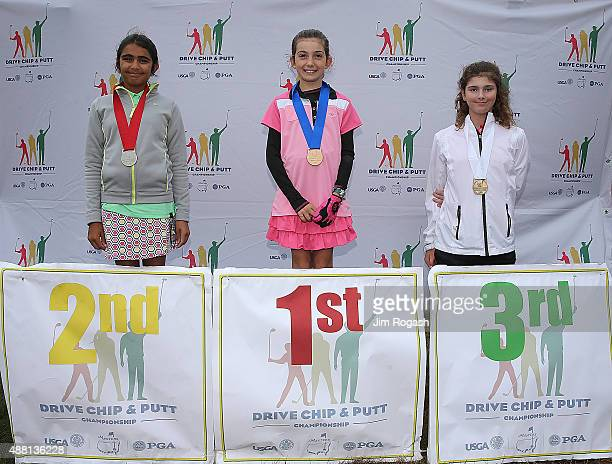 Shivani Dora second place winner Nicole Criscone first place winner and Sydney Hidalgo third place winner in the Girls 1011Overall Competition pose...